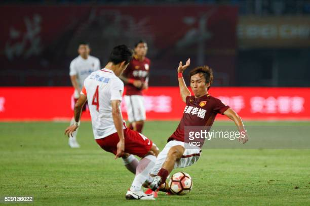 Yin Hongbo of Hebei China Fortune Wang Shenchao of Shanghai SIPG vie for the ball during the 21st round match of 2017 China Super League between...