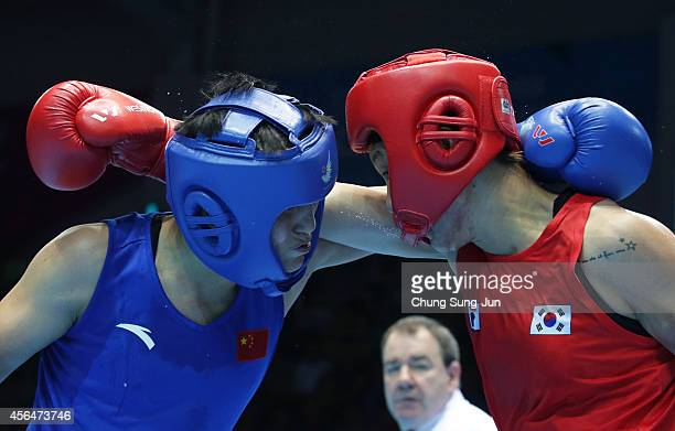 Yin Junhua of China competes with Park JiNa of South Korea in the Women¡¯s Light Division Final on day twelve of the 2014 Asian Games at Seonhak...