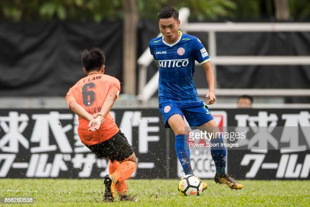 Yin Kwok Chuck of BC Rangers fights for the ball with Chun Ting Law of Sun Bus Yeun Long during the Hong Kong Premier League Week 4 match between BC...