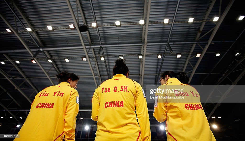 Yin Liu, Qingshuang Yue and Yan Zhou of China speak during the break in the match between Germany and China on Day 4 of the Titlis Glacier Mountain World Women's Curling Championship at the Volvo Sports Centre on March 19, 2013 in Riga, Latvia.