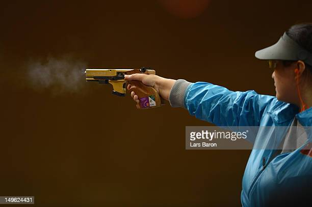 Ying Chen of China competes in the Women's 25m Pistol Shooting final on Day 5 of the London 2012 Olympic Games at The Royal Artillery Barracks on...