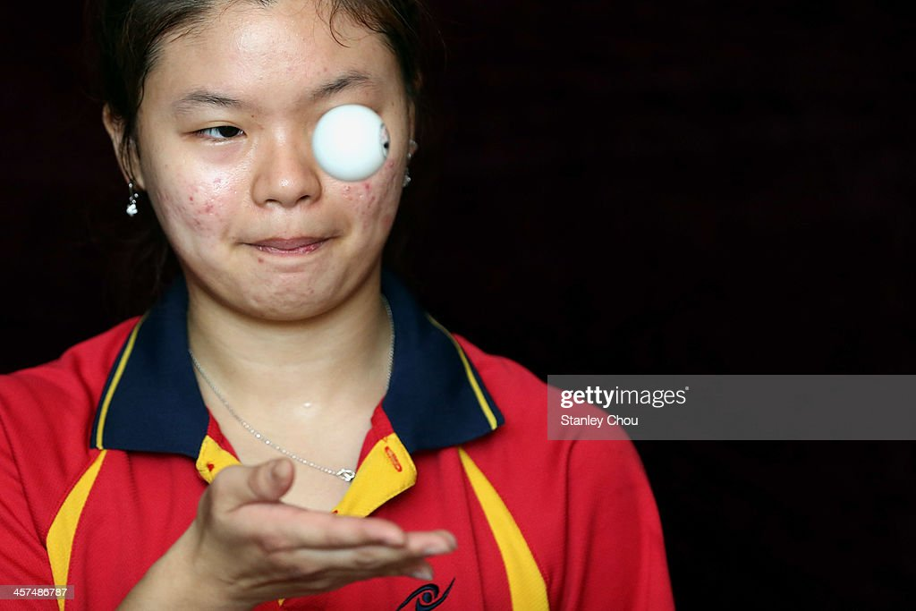 Ying Ho of Malaysia serves against Yihan Zhou of Singapore during the Women's Table Tennis Team Competition during the 2013 SEA Games at the Wunna Theikdi Indoor Stadium on December 18, 2013 in Nay Pyi Taw, Burma.