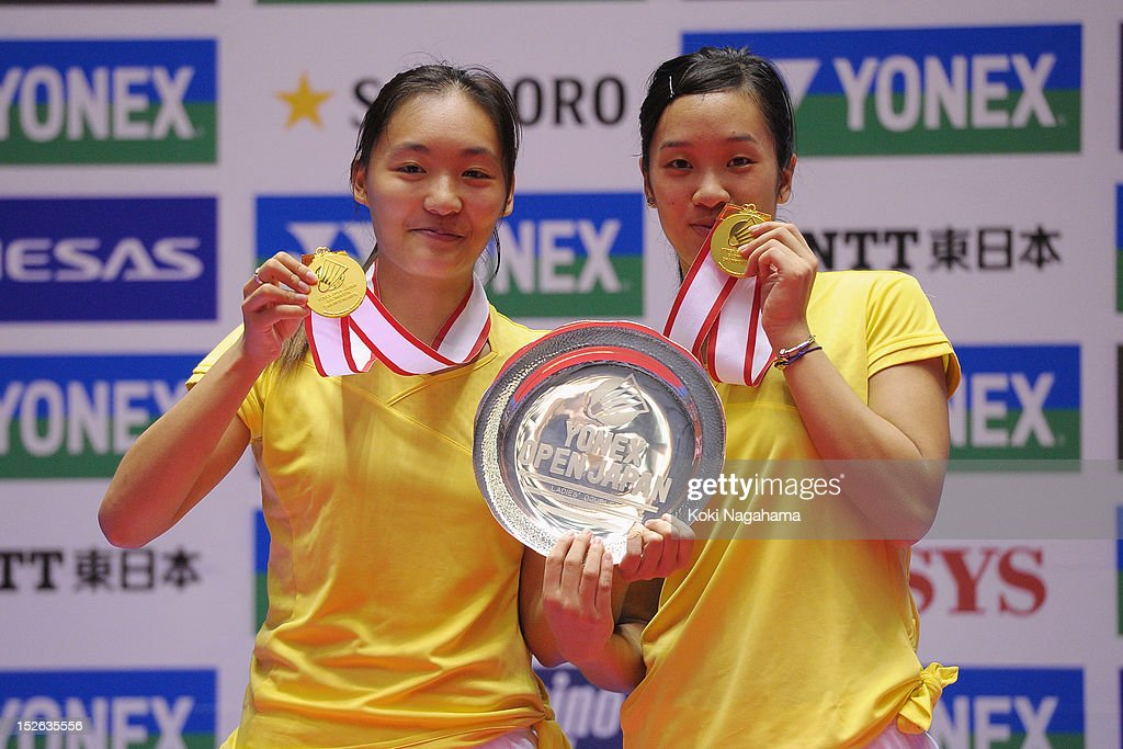Ying Suet Tse and Lok Yan Poon of Hong Kong China pose on the podium after winning the women's doubles against Shizuka Matsuo and Mami Naito of Japan during day five of the Yonex Open Japan 2012 at Yoyogi Gymnasium on September 23, 2012 in Tokyo, Japan.