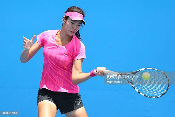 Ying Zhang of China plays a forehand in her second round junior girls' match against Anastasiya Komardina of Russia during the 2014 Australian Open...