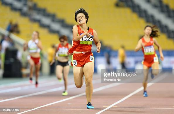 Yingli Li of China wins the women's 200m T37 final during the Evening Session on Day Eight of the IPC Athletics World Championships at Suhaim Bin...