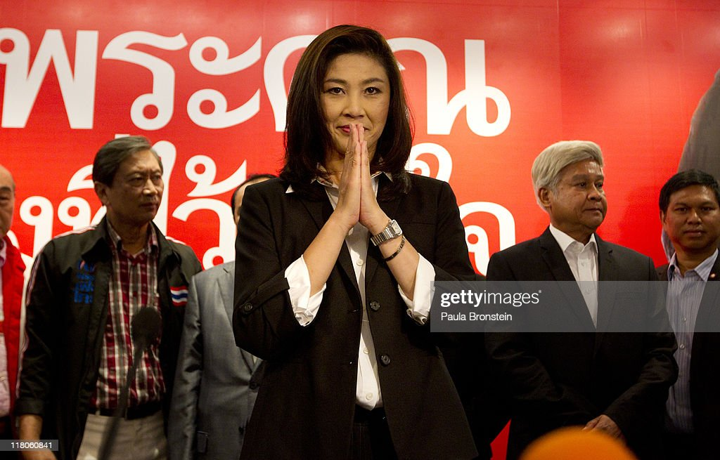 <a gi-track='captionPersonalityLinkClicked' href=/galleries/search?phrase=Yingluck+Shinawatra&family=editorial&specificpeople=787330 ng-click='$event.stopPropagation()'>Yingluck Shinawatra</a> greets the media before giving a celebration speech at the Pue Thai party headquarters July 3, 2011 in Bangkok, Thailand. Early exit polls put Yingluck, the sister of ousted former leader Thaksin Shinawatra ahead as Thai Prime Minister Abhisit Vejjajiva concedes the election. The apparent election result paves the way for <a gi-track='captionPersonalityLinkClicked' href=/galleries/search?phrase=Yingluck+Shinawatra&family=editorial&specificpeople=787330 ng-click='$event.stopPropagation()'>Yingluck Shinawatra</a> to become Thailand's first female prime minister.
