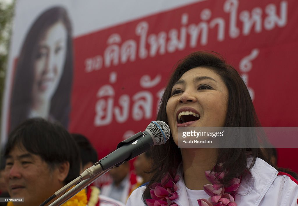 Yingluck Shinawatra speaks during a rally during her election campaign June 29, 2011 in Burirum,Thailand. Thai's go to the polls on July 3, during a tight race with Prime Minister Abhisit Vejjajiva's Democrats against the red shirt followers of fugitive former premier Thaksin Shinawatra, ousted in a 2006 coup.