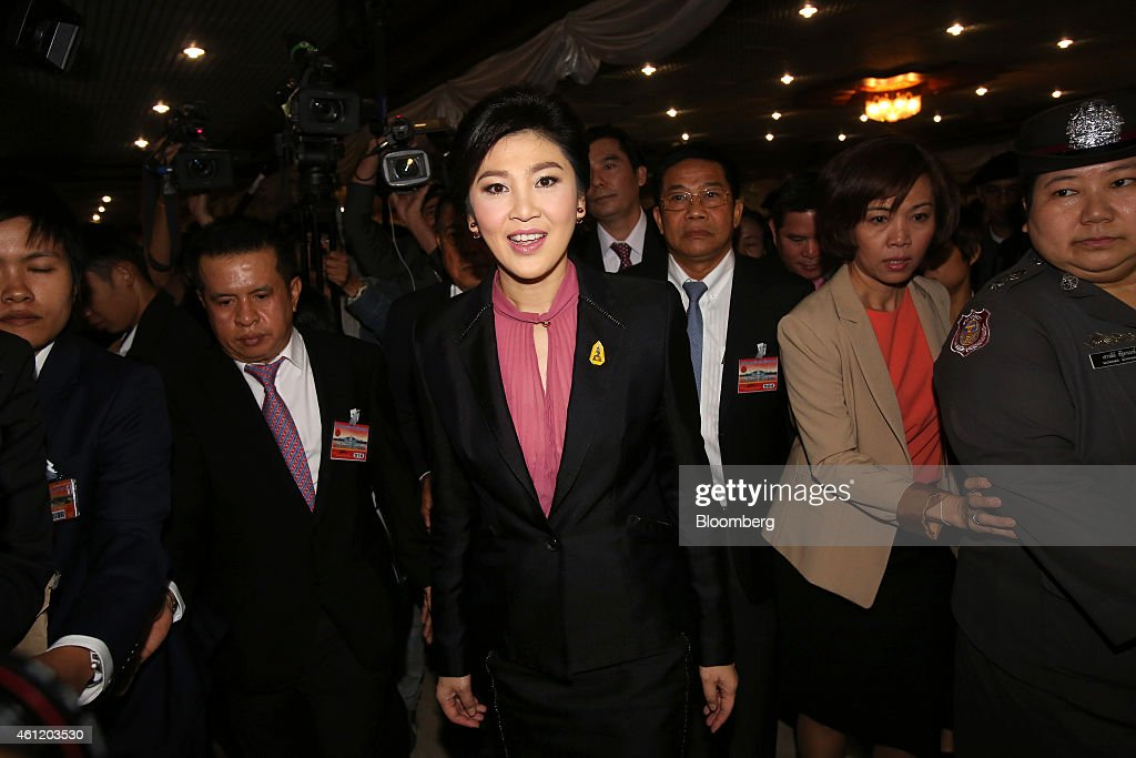 Yingluck Shinawatra, Thailand's former prime minister, center, arrives at Parliament House in Bangkok, Thailand, on Friday, Jan. 9, 2015. Thailands junta-appointed legislature, stacked with military men, will today start impeachment hearings against Yingluck for her part in the nations loss-making rice purchasing program. Photographer: Dario Pignatelli/Bloomberg via Getty Images