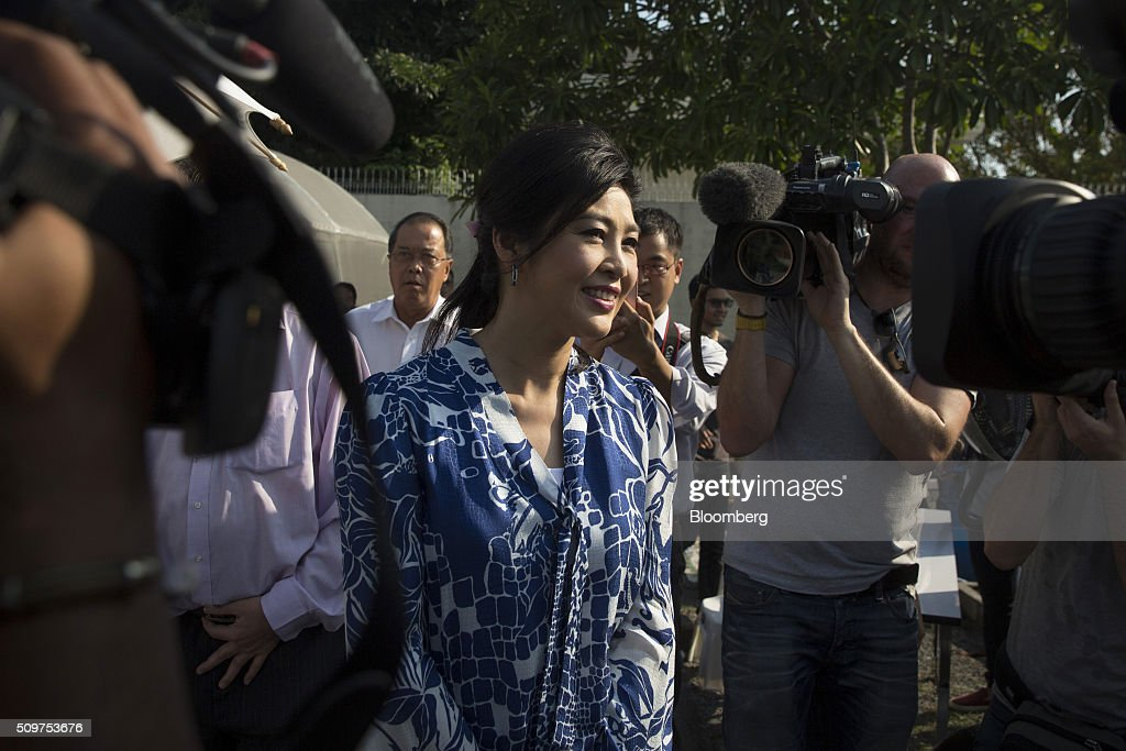 <a gi-track='captionPersonalityLinkClicked' href=/galleries/search?phrase=Yingluck+Shinawatra&family=editorial&specificpeople=787330 ng-click='$event.stopPropagation()'>Yingluck Shinawatra</a>, Thailand's former prime minister, greets members of the media during a news conference at her home in Bangkok, Thailand, on Friday, Feb. 12, 2016. Yingluck, whose government was ousted in a military coup, is engaged in a criminal trial on charges she was negligent in overseeing a rice purchasing program. She has denied the allegations, saying the case is politically motivated and being pushed by the forces behind the May 2014 military coup that toppled her elected government. Photographer: Brent Lewin/Bloomberg via Getty Images