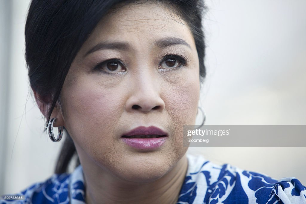 <a gi-track='captionPersonalityLinkClicked' href=/galleries/search?phrase=Yingluck+Shinawatra&family=editorial&specificpeople=787330 ng-click='$event.stopPropagation()'>Yingluck Shinawatra</a>, Thailand's former prime minister, looks on during a news conference at her home in Bangkok, Thailand, on Friday, Feb. 12, 2016. Yingluck, whose government was ousted in a military coup, is engaged in a criminal trial on charges she was negligent in overseeing a rice purchasing program. She has denied the allegations, saying the case is politically motivated and being pushed by the forces behind the May 2014 military coup that toppled her elected government. Photographer: Brent Lewin/Bloomberg via Getty Images