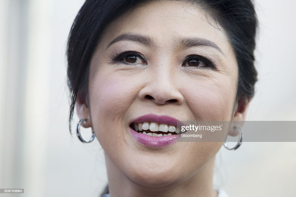 <a gi-track='captionPersonalityLinkClicked' href=/galleries/search?phrase=Yingluck+Shinawatra&family=editorial&specificpeople=787330 ng-click='$event.stopPropagation()'>Yingluck Shinawatra</a>, Thailand's former prime minister, reacts during a news conference at her home in Bangkok, Thailand, on Friday, Feb. 12, 2016. Yingluck, whose government was ousted in a military coup, is engaged in a criminal trial on charges she was negligent in overseeing a rice purchasing program. She has denied the allegations, saying the case is politically motivated and being pushed by the forces behind the May 2014 military coup that toppled her elected government. Photographer: Brent Lewin/Bloomberg via Getty Images