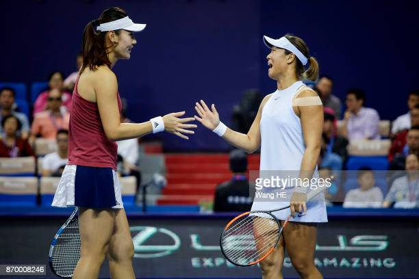 Yingying Duan and Xinyun Han of China talks in their doubles Semifinal match against Chen Liang of China and her partner Zhao xuanyang of China...