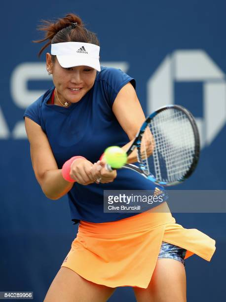 YingYing Duan of China returns a shot during her first round Women's Singles match against Claire Liu of the United States on Day One of the 2017 US...