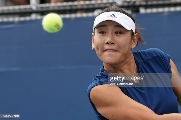 YingYing Duan of China returns the ball to Claire Liu of the US during their Women's Singles match at the 2017 US Open Tennis Tournament on August 28...