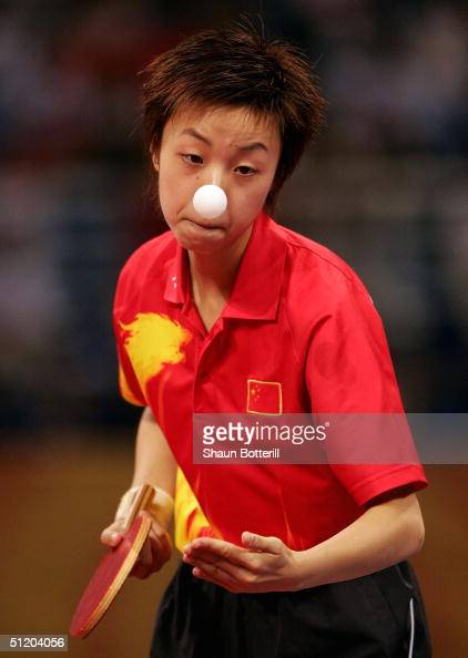 Yining Zhang of China in action in the women's singles table tennis gold medal match on August 22 2004 during the Athens 2004 Summer Olympic Games at...