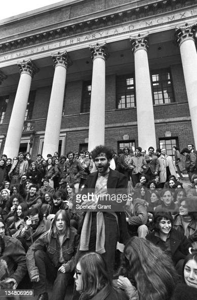 Yippie Jerry Rubin and fans on steps of Harvard's Weidner Library Cambridge Massachusetts 1970