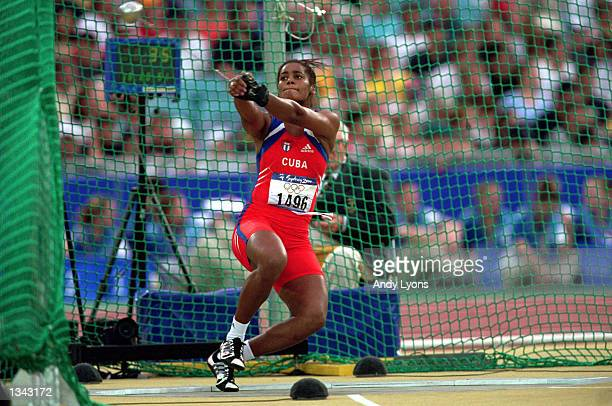 Yipsi Moreno of Cuba throws the Hammer in the Womens Hammer Throw during the Sydney 2000 Olympic Games on September 29 2000 at the Sydney Stadium in...
