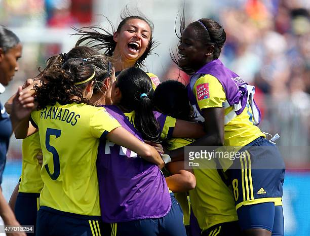 Yisela Cuesta of Colombia and the rest of the team celebrate the win over France during the FIFA Women's World Cup 2015 Group F match at Moncton...