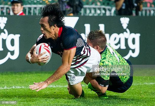 Yiu Kam Shing of Hong Kong is tackled during the 2016 Hong Kong Sevens match between Spain and Hong Kong at Hong Kong Stadium on April 9 2016 in Hong...