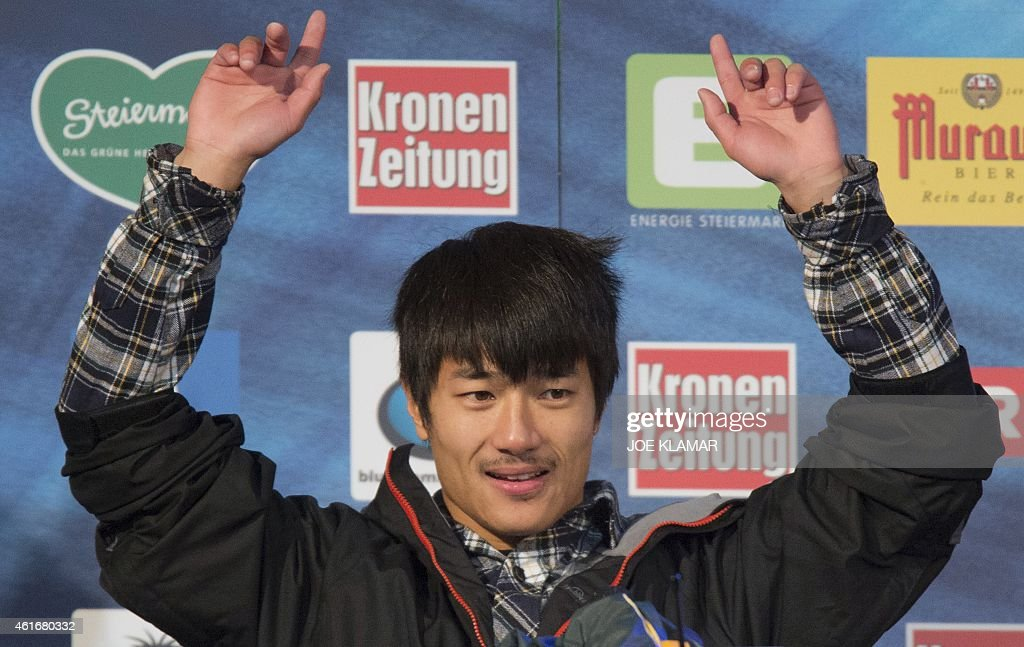 <a gi-track='captionPersonalityLinkClicked' href=/galleries/search?phrase=Yiwei+Zhang&family=editorial&specificpeople=8090733 ng-click='$event.stopPropagation()'>Yiwei Zhang</a> of China celebrates on the podium of the Men's Snowboard Halfpipe competition of the FIS Freestyle and Snowboarding World Ski Championships 2015 in Kreischberg, Austria on January 17, 2015. Australia's Scotty James won gold ahead of the <a gi-track='captionPersonalityLinkClicked' href=/galleries/search?phrase=Yiwei+Zhang&family=editorial&specificpeople=8090733 ng-click='$event.stopPropagation()'>Yiwei Zhang</a> of China and Tim-Kevin Ravnjak of Slovenia.