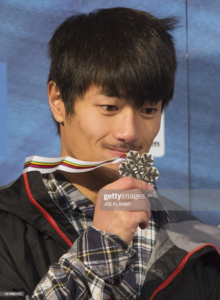 <a gi-track='captionPersonalityLinkClicked' href=/galleries/search?phrase=Yiwei+Zhang&family=editorial&specificpeople=8090733 ng-click='$event.stopPropagation()'>Yiwei Zhang</a> of China poses with his medal on the podium of the Men's Snowboard Halfpipe competition of the FIS Freestyle and Snowboarding World Ski Championships 2015 in Kreischberg, Austria on January 17, 2015. Australia's Scotty James won gold ahead of the <a gi-track='captionPersonalityLinkClicked' href=/galleries/search?phrase=Yiwei+Zhang&family=editorial&specificpeople=8090733 ng-click='$event.stopPropagation()'>Yiwei Zhang</a> of China and Tim-Kevin Ravnjak of Slovenia.