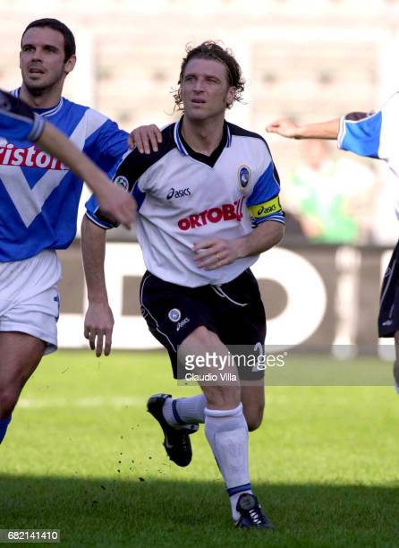 Yllana of Brescia and Massimo Carrera of Atalanta during the SERIE A 23rd Round League match between Brescia and Atalanta played at the Giglio...