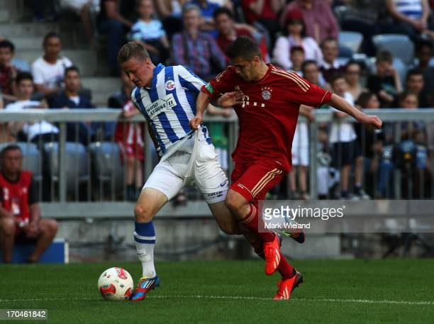 Ylli Sallahi of FC Bayern Muenchen U19 challenges Bjorn Schlottke of Hansa Rostock U19 during the A Juniors championship first leg match between FC...