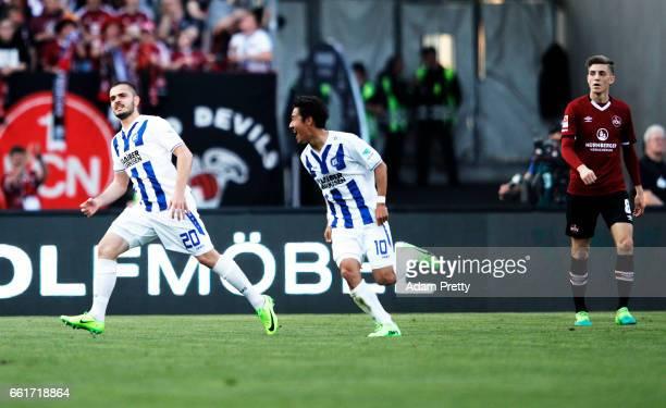 Ylli Sallahi of Karlsruher celebrates with Hiroki Yamada of Karlsruher SC after scoring a goal during the Second Bundesliga match between 1 FC...