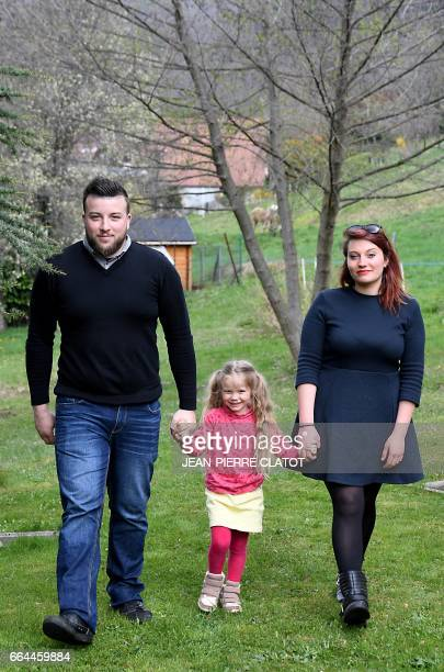 Yoan Bombarde and Sabrina Dietsch pose with their daughter Louna who is affected by a rare hireditory disease known as 'Angiodema' on April 4 2017 in...