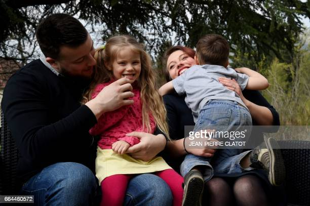 Yoan Bombarde and Sabrina Dietsch pose with their daughter Louna who is affected by a rare hireditory disease known as 'Angiodema' and their son Leo...