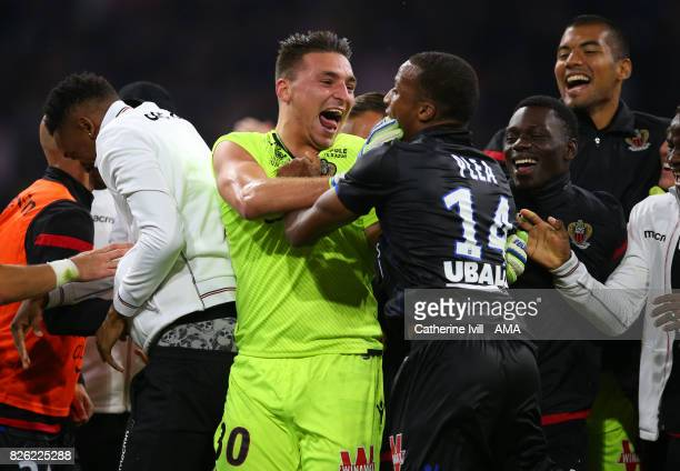 Yoan Cardinale of OGC Nice celebrates with Alassane Plea of OGC Nice during the UEFA Champions League Qualifying Third Round match between Ajax and...