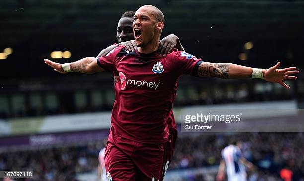 Yoan Gouffran celebrates after scoring the opening goal for Newcastle during the Barclays Premier League match between West Bromwich Albion and...