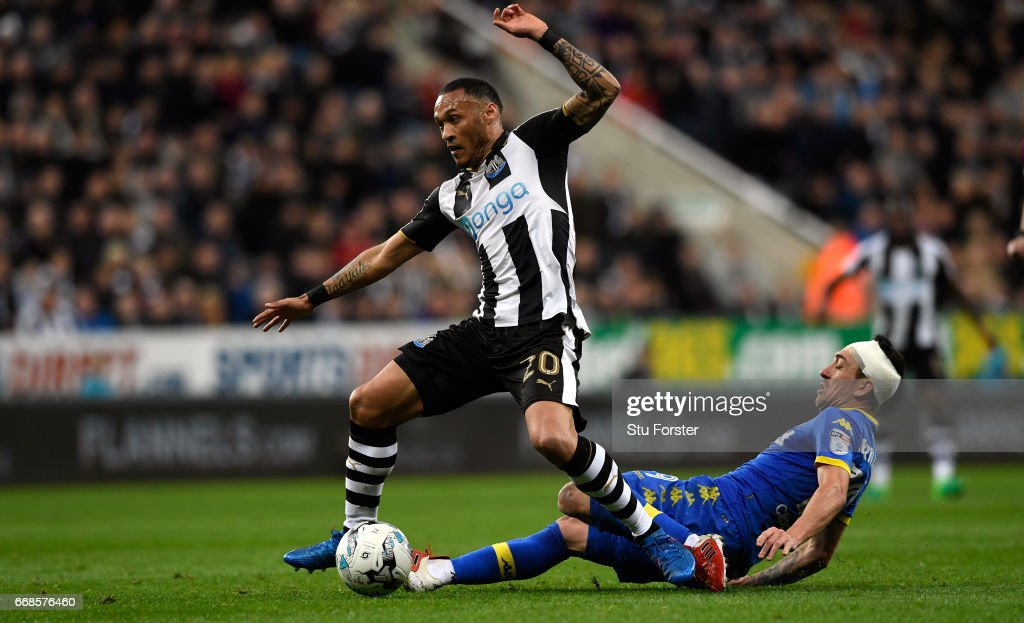 Yoan Gouffran is tackled by Pablo Hernandez of Leeds during the Sky Bet Championship match between Newcastle United and Leeds United at St James' Park on April 14, 2017 in Newcastle upon Tyne, England.