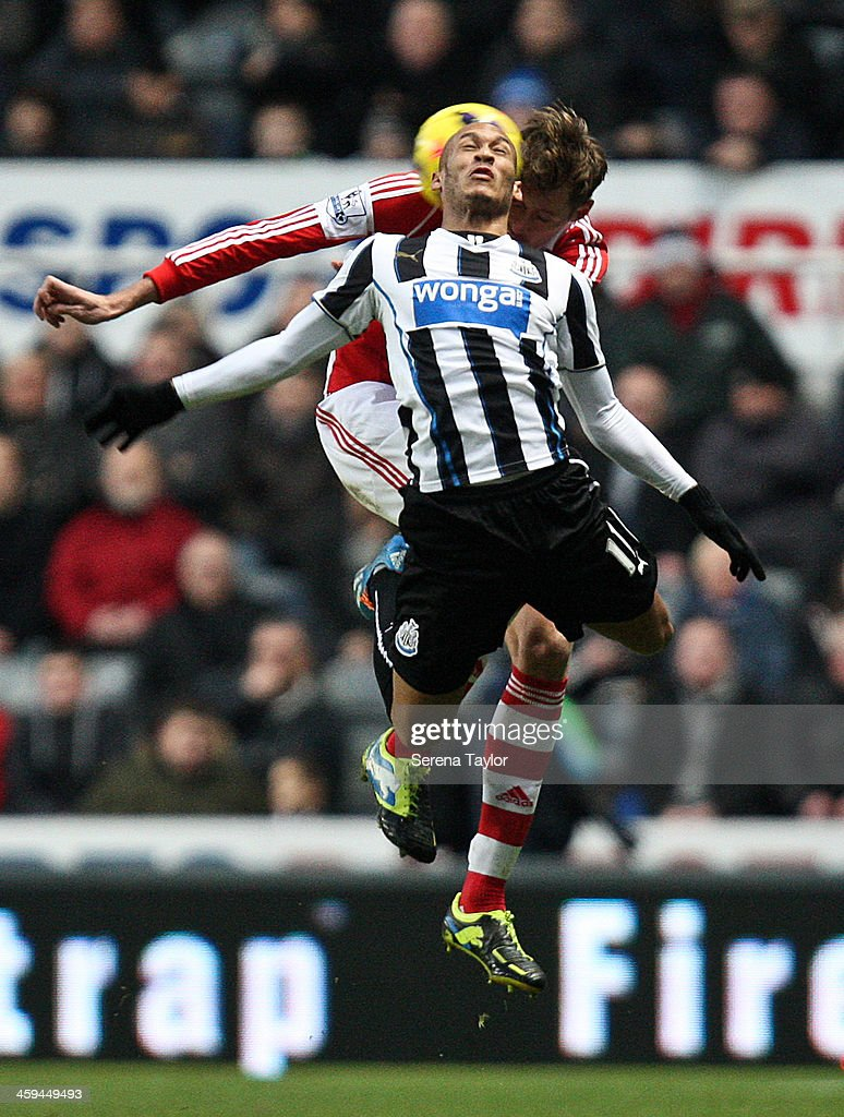 <a gi-track='captionPersonalityLinkClicked' href=/galleries/search?phrase=Yoan+Gouffran&family=editorial&specificpeople=534470 ng-click='$event.stopPropagation()'>Yoan Gouffran</a> of Newcastle is challenged by <a gi-track='captionPersonalityLinkClicked' href=/galleries/search?phrase=Peter+Crouch&family=editorial&specificpeople=210764 ng-click='$event.stopPropagation()'>Peter Crouch</a> of Stoke City during the Barclays Premier League match between Newcastle United and Stoke City at St. James' Park on December 26, 2013, in Newcastle upon Tyne England.