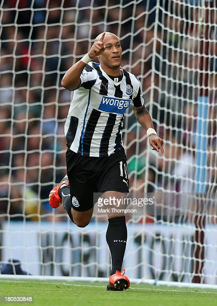 Yoan Gouffran of Newcastle United celebrates after scoring their second goal during the Barclays Premier League match between Aston Villa and...