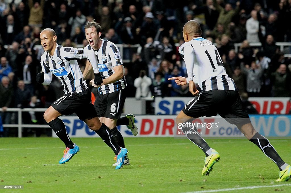 <a gi-track='captionPersonalityLinkClicked' href=/galleries/search?phrase=Yoan+Gouffran&family=editorial&specificpeople=534470 ng-click='$event.stopPropagation()'>Yoan Gouffran</a> (left) of Newcastle United celebrates scoring the opening goal during the Barclays Premier League match between Newcastle United and West Bromwich Albion at St James' Park on November 30, 2013 in Newcastle upon Tyne, England