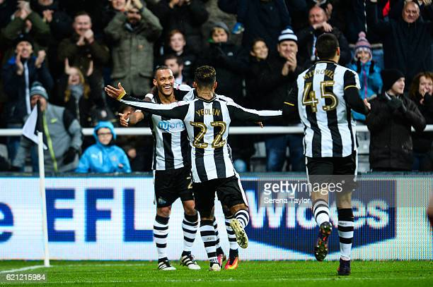 Yoan Gouffran of Newcastle United celebrates with teammate DeAndre Yedlin after scoring Newcastle's second goal during the Sky Bet Championship match...
