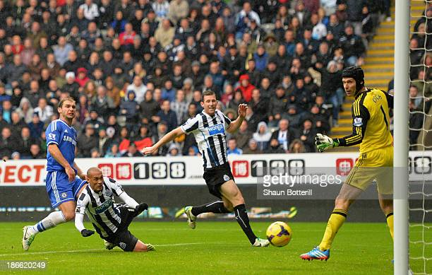 Yoan Gouffran of Newcastle United heads the first goal past Petr Cech of Chelsea during the Barclays Premier League match between Newcastle United...