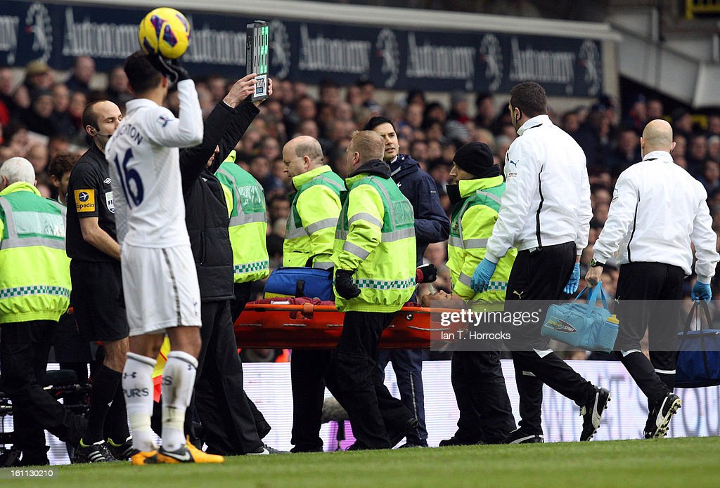 Yoan Gouffran of Newcastle United is carried off after being injured during the Barclays Premier League match between Tottenham Hotspur and Newcastle United at White Hart Lane on February 09, 2013 in London, England.