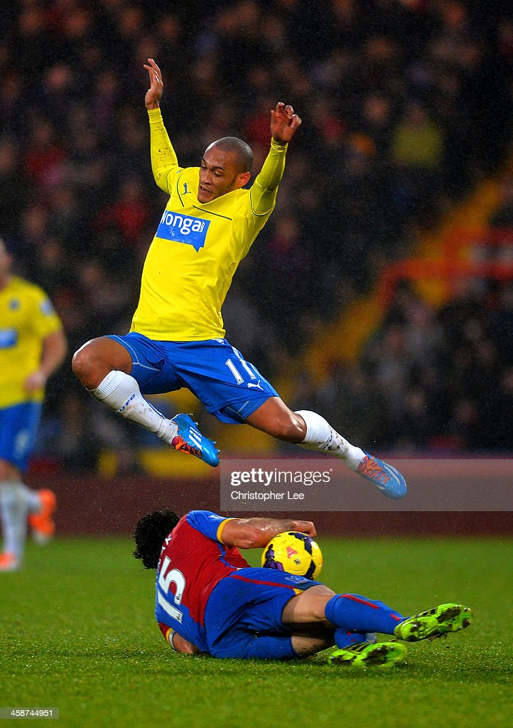 <a gi-track='captionPersonalityLinkClicked' href=/galleries/search?phrase=Yoan+Gouffran&family=editorial&specificpeople=534470 ng-click='$event.stopPropagation()'>Yoan Gouffran</a> of Newcastle United leaps over <a gi-track='captionPersonalityLinkClicked' href=/galleries/search?phrase=Mile+Jedinak&family=editorial&specificpeople=3123629 ng-click='$event.stopPropagation()'>Mile Jedinak</a> of Crystal Palace during the Barclays Premier League match between Crystal Palace and Newcastle United and Selhurst Park on December 21, 2013 in London, England.