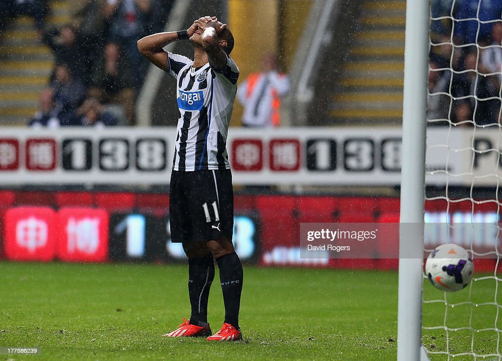Yoan Gouffran of Newcastle United looks dejected after missing a last minute open goal during the Barclays Premier League match between Newcastle United and West Ham United at St James' Park on August 24, 2013 in Newcastle upon Tyne, England.
