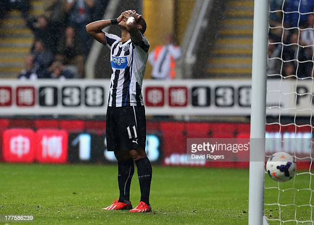 Yoan Gouffran of Newcastle United looks dejected after missing a last minute open goal during the Barclays Premier League match between Newcastle...