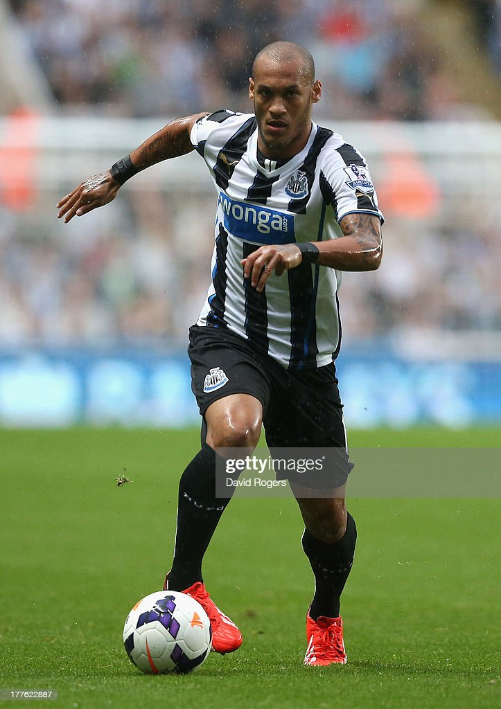 Yoan Gouffran of Newcastle United runs with the ball during the Barclays Premier League match between Newcastle United and West Ham United at St James' Park on August 24, 2013 in Newcastle upon Tyne, England.