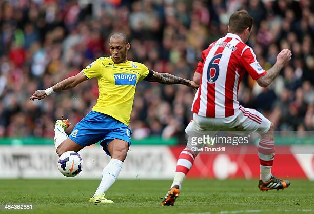 Yoan Gouffran of Newcastle United shoots towards Glenn Whelan of Stoke City during the Barclays Premier League match between Stoke City and Newcastle...