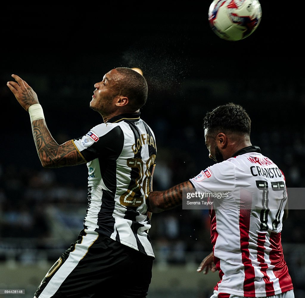 Yoan Gouffran of Newcastle United wins a header over Jordan Cranston of Cheltenham Town during the EFL cup between Newcastle United and Cheltenham...