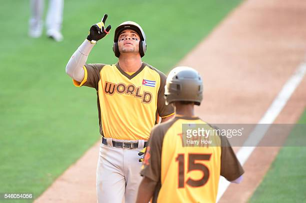 Yoan Moncada of the Boston Red Sox and the World Team celebrates after scoring during the SiriusXM AllStar Futures Game at PETCO Park on July 10 2016...