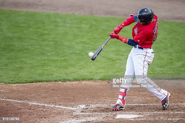 Yoan Moncada of the Boston Red Sox hits a single in an exhibition game against the Northeastern University Huskies on February 29 2016 at jetBlue...