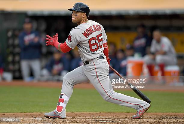 Yoan Moncada of the Boston Red Sox hits a tworun rbi double against the Oakland Athletics in the top of the third inning at OaklandAlameda County...