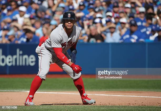 Yoan Moncada of the Boston Red Sox leads off first base in the eighth inning during MLB game action against the Toronto Blue Jays on September 10...