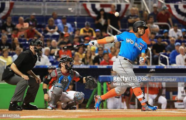 Yoan Moncada of the Chicago White Sox and the World Team bats against the US Team in the first inning during the SiriusXM AllStar Futures Game at...